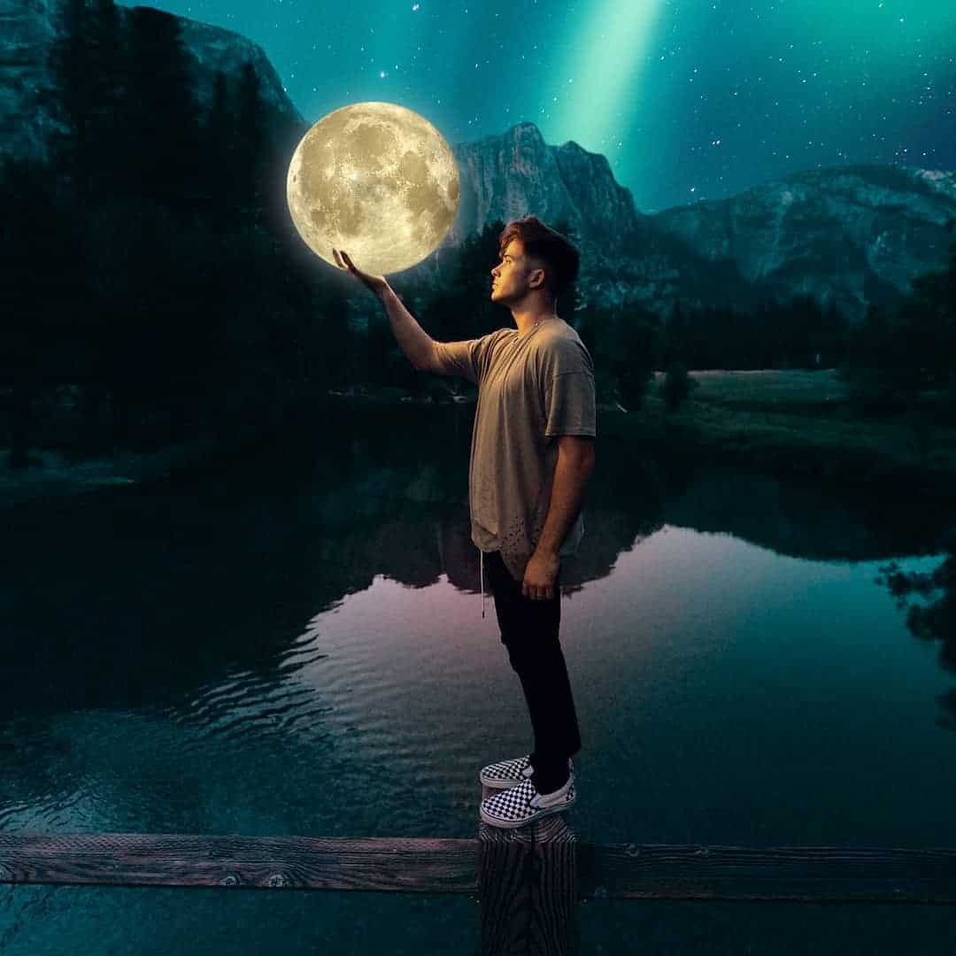 guy holding a moon in his hand