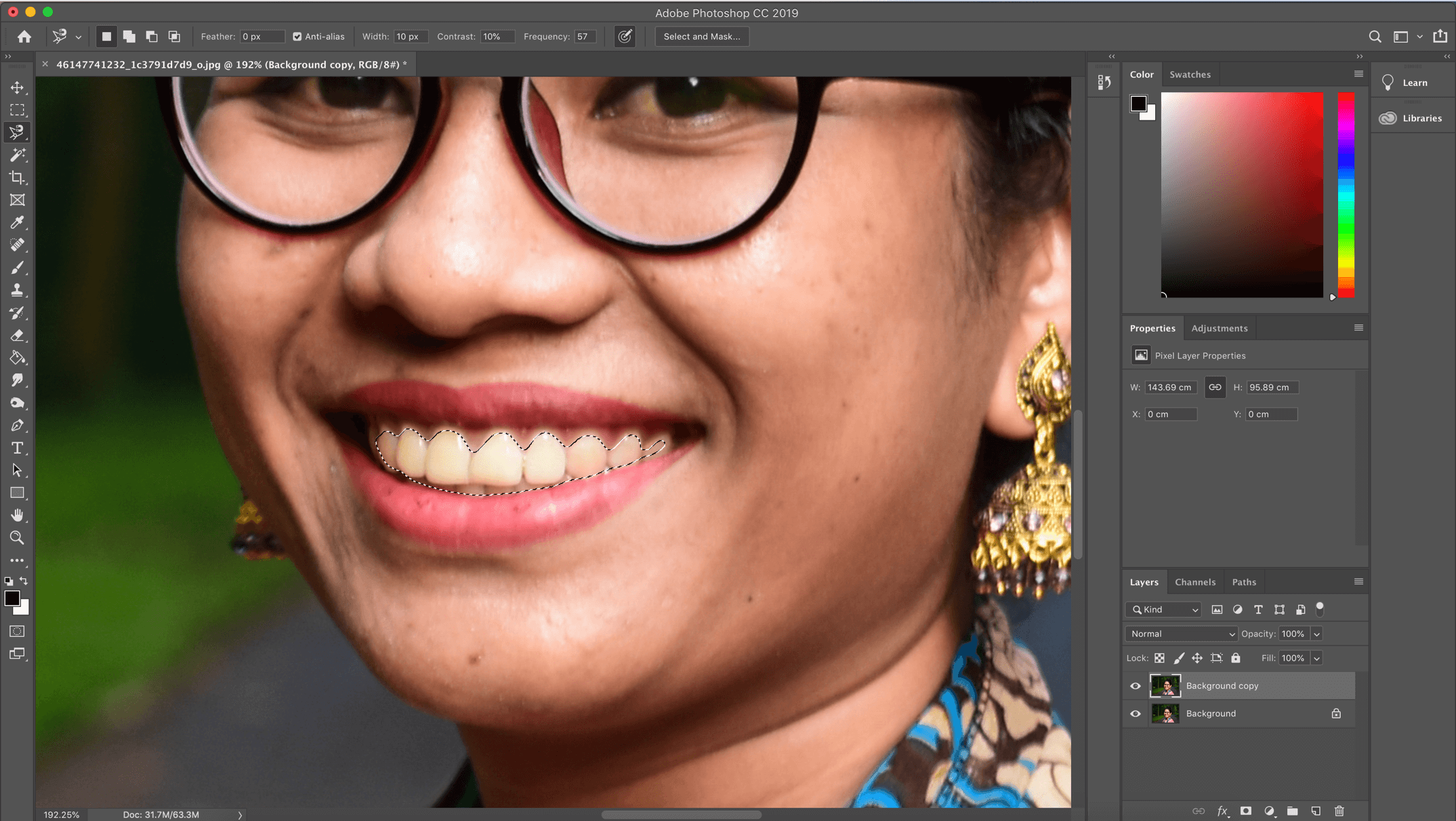Asian girl with teeth selected in Photoshop