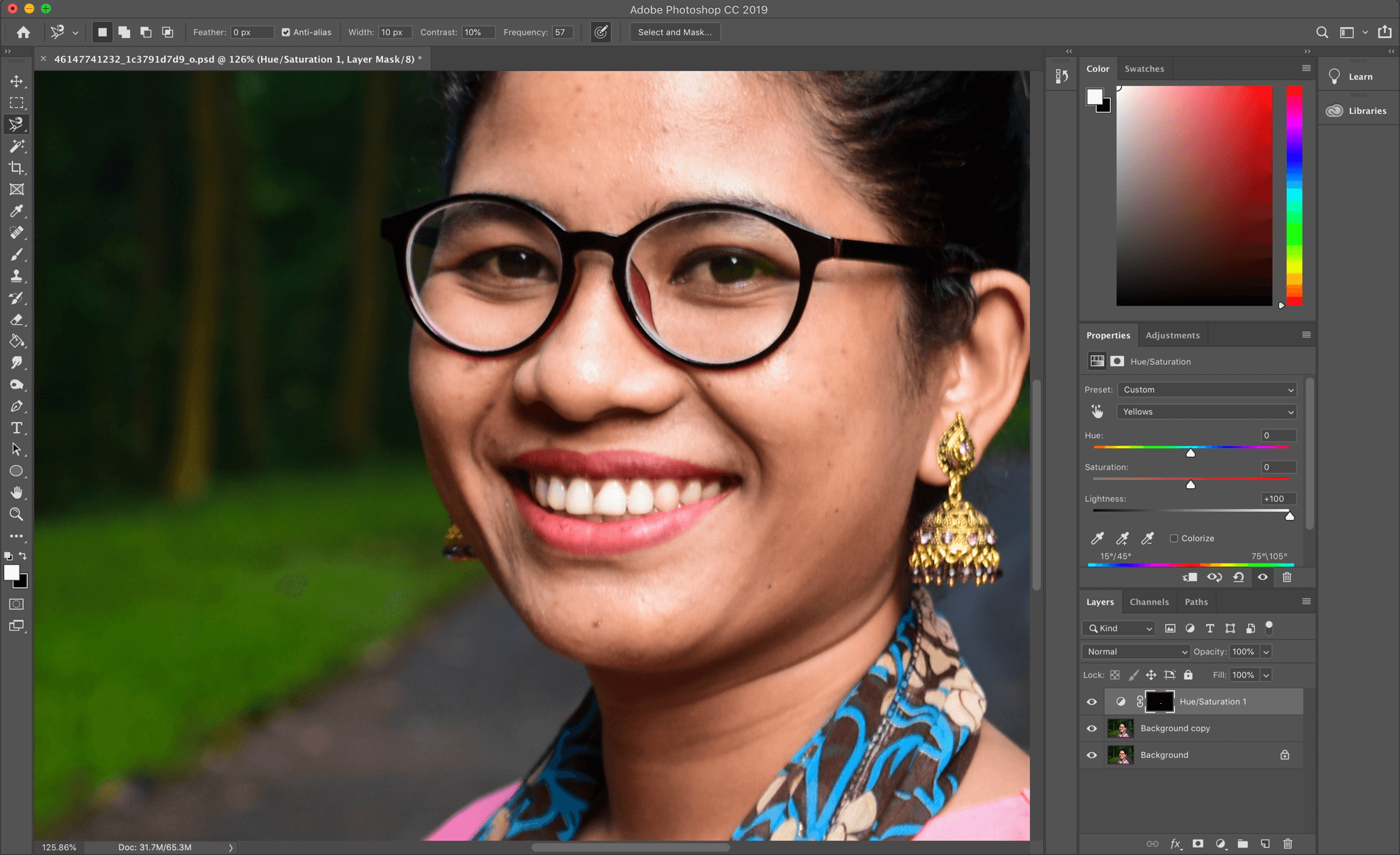 Smiling asian girl in Adobe Photoshop Software
