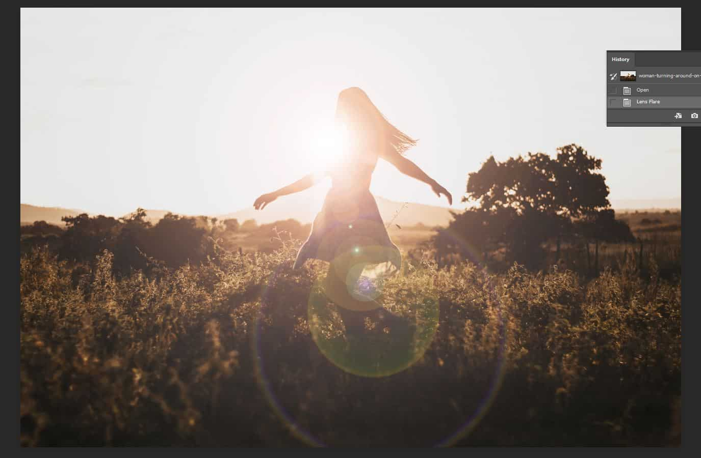 dancing woman with lens flare photoshop